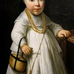 bambina accanto al seggiolone